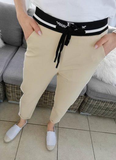 Casualowe beżowe spodnie z białym lampasem Bonbon