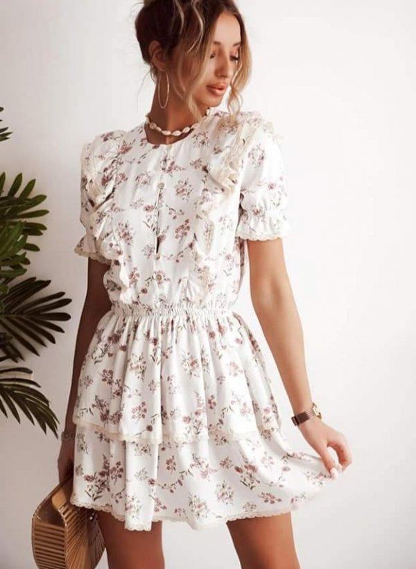 Sukienka Carrara w kwiaty z żabotem i falbankami